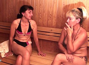 Mature ladies relaxing in a sauna