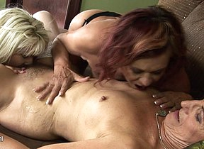 Two horny mature lesbians share a hot babe