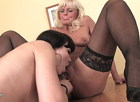 This horny mama gets two cocks to process