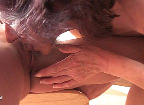 Mature lesbian having fun with a hot young babe