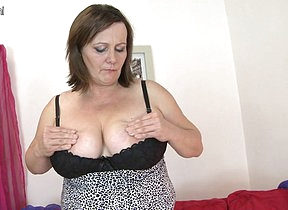 Big breasted mature slut playing with her pussy