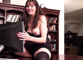 Naughty American housewife getting wet in front of her computer