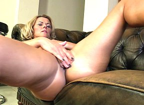 Naughty blonde Cougar playing on her couch with her wet pussy