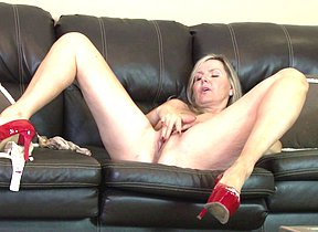 Hot British Cougar masturbating on the couch