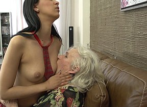 Hairy granny getting licked by a hot young lesbian babe