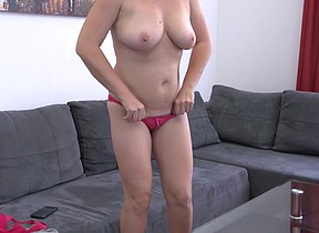 Horny mature slut playing on her couch