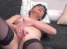 This naughty housewife enjoys toying with herself