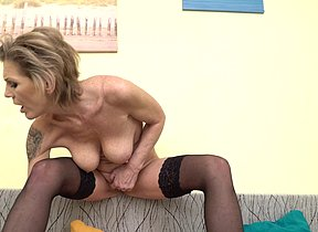 Naughty mature lady frolicking with her pussy