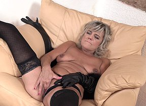 Crazy cougar frigging herself on the couch