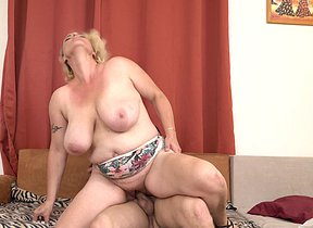 Fat titted mature chick blowing a rockhard trouser snake